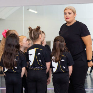 Children with teacher in group drama class at theatre school Jac Jossa in Bexleyheath